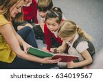 teacher is sitting in the... | Shutterstock . vector #634019567