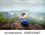 women travel sit on a cliff on... | Shutterstock . vector #634019687