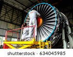Small photo of BANGKOK, THAILAND - MAY 4, 2017 :: AERONAUTICAL ENGINEER ARE DOING MAINTENANCE AIRCRAFT ENGINE IN CIVIL AVIATION CENTER ENGINE OVERHAUL SHOP.