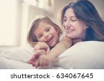 mother with her cute little... | Shutterstock . vector #634067645