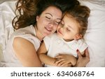 mother and daughter sleeping... | Shutterstock . vector #634068764