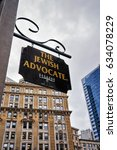 Small photo of Boston, USA - April 28, 2015: Jewish Advocate wooden plate on Milk Street in downtown Boston, Massachusetts, the United States.
