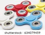 colourful fidget finger spinner ...   Shutterstock . vector #634079459