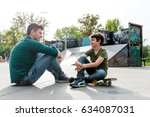 father and son talking in skate ... | Shutterstock . vector #634087031