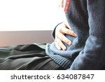 menstrual pain  closeup woman... | Shutterstock . vector #634087847