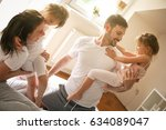 cheerful family playing... | Shutterstock . vector #634089047