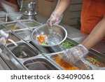 the cook puts pieces of... | Shutterstock . vector #634090061