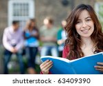 female student outdoors with a... | Shutterstock . vector #63409390
