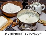 bechamel sauce in a pan and... | Shutterstock . vector #634096997