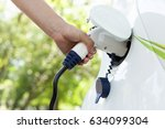 hand holding an electric plug... | Shutterstock . vector #634099304
