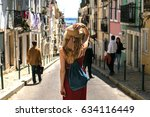 young travel woman is walking... | Shutterstock . vector #634116449