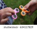 two fidget spinners   Shutterstock . vector #634117829