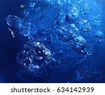 blue water and air bubbles  | Shutterstock . vector #634142939