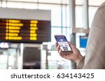 boarding pass in smartphone.... | Shutterstock . vector #634143425