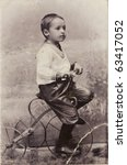 a little boy on a bicycle  old...   Shutterstock . vector #63417052
