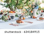 outdoor summer wedding... | Shutterstock . vector #634184915