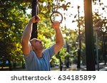 man gymnastics rings in the... | Shutterstock . vector #634185899