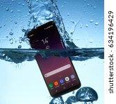 samsung galaxy s8 in water | Shutterstock . vector #634196429