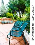 metal green chairs  benches ... | Shutterstock . vector #634220114