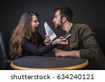 Small photo of Husband and wife fighting over money and expenses, loudly and passionately