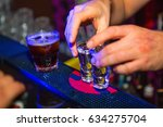 alcohol cocktail on the bar.... | Shutterstock . vector #634275704