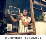 Woman Hanging Open Sign By The...