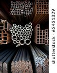 Different sizes of metal pipes on shelf - stock photo