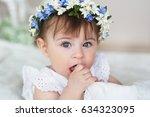 portrait of little girl in a... | Shutterstock . vector #634323095