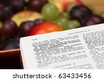 Small photo of Holy Bible open to Galatians 5. Focus on verse 22. Fruit of the Spirit.