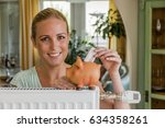 woman with radiator and piggy... | Shutterstock . vector #634358261