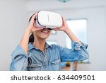 woman looking with virtual... | Shutterstock . vector #634409501