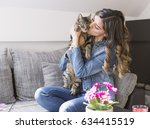 Stock photo woman portrait with her cat 634415519