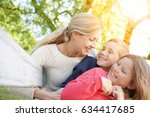 mother with kids having fun... | Shutterstock . vector #634417685