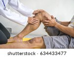physiotherapist giving exercise ... | Shutterstock . vector #634433477
