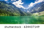 stunning pond in the mountains... | Shutterstock . vector #634437149
