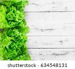 fresh lettuce leaves border... | Shutterstock . vector #634548131