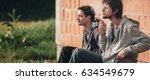 young urban friends smoke... | Shutterstock . vector #634549679