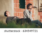 young urban friends smoke... | Shutterstock . vector #634549721