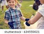 group of diversity people... | Shutterstock . vector #634550021