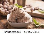 hazelnut ice cream on a wooden...   Shutterstock . vector #634579511