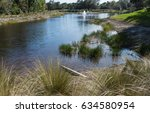 golf course community pond in... | Shutterstock . vector #634580954