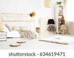 little girl standing in a... | Shutterstock . vector #634619471