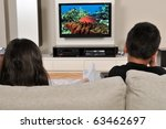 two kids on couch watching tv ... | Shutterstock . vector #63462697