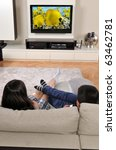 laying on sofa and watching tv  ... | Shutterstock . vector #63462781