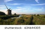 old windmill by the water on... | Shutterstock . vector #634644305