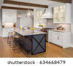 kitchen in new luxury home with ... | Shutterstock . vector #634668479