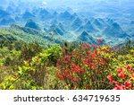 azalea flowers and mountains... | Shutterstock . vector #634719635