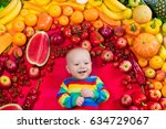 baby boy with variety of fruit... | Shutterstock . vector #634729067