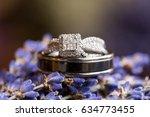 wedding rings on lavendar... | Shutterstock . vector #634773455