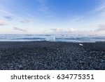 black rock and sand beach... | Shutterstock . vector #634775351